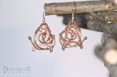 """Live Long and Prosper - OOAK  The Star Trek resemblance was an unintentional silver lining (that was an intentional pun)!  Square copper wire, hand-formed and soldered, adorned with freeform copper wire and a 3mm glass pearl. The nature of this technique means that these earrings are one of a kind (OOAK).  Length: 3.8cm/1.5""""  ** All my ear posts are made of sterling silver and are nickel free."""