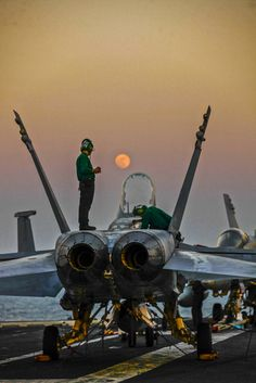 ARABIAN GULF (Jan. 4, 2015) Sailors assigned to the Mighty Shrikes of Strike Fighter Squadron (VFA) 94 conduct maintenance on an F/A-18C Hornet on the flight deck of the aircraft carrier USS Carl Vinson (CVN 70).