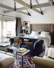 bedroom with sofa and upholstered headboard