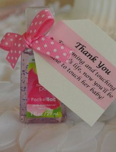 """Ha! Cute party favor for a Baby Shower. """"Thank you for coming and touching (the mother's) life, now you'll be able to touch her baby!"""""""