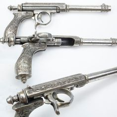 Joalland Needle-fire pistol - This all-metal Louis Joalland pistol was made in Bourges, France and like the Dreyse rifle, this handgun is a single shot design, opening by twisting to the right and pulling back to insert a cartridge into the chamber. The engraving on this pistol includes stylized griffins amidst the raised scroll embellishments. The blackpowder propellant of that period was fairly corrosive. This .40 caliber handgun, on display in the National Firearms Museum in Fairfax, VA.