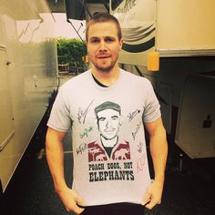 For chance to win #Arrow cast signed #PoachEggsNotElephants T-shirt as worn by amellywood - Paul