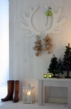 "I really like the idea of cutting some ""reindeer"" antlers out of cardboard  and hanging some ornaments or gifts from them!"