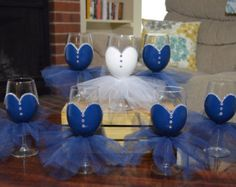 This set of 5 (4 bridesmaids and 1 bride) hand painted wine glasses (12 oz) with tulle skirt are sure to be a hit at any bridal shower,