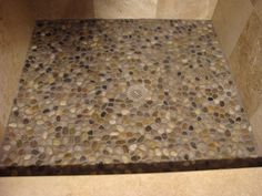 """Shower Floor... We have a box of these type of """"rock"""" floor panels, can't wait to complete our shower."""