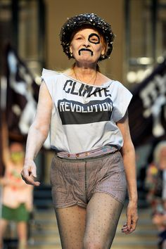"""Dame Vivienne Westwood channeling Little Edie Beale.  """"The best kind of clothes for a protest pose is this ensemble of pantyhose.  Pulled over the shorts, worn under the skirt that doubles as a cape."""""""