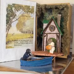 Messing about in boats, from Wind in the Willows. Made in a book box, from foamcore, paper and polymer clay.
