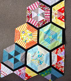 PatchworknPlay.  Colorful hexagons with black spacers setting off the colors