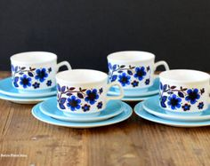 Staffordshire Potteries trios (teacup, saucer, small plate), set of four