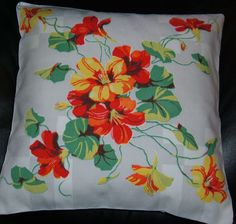 Check out eBay seller, collectorspd for these affordable, gift-able, fabulous pillow covers made out of vintage Wilendur tablecloth scraps.  Even with the cost of the pillow form that you buy locally, you can keep or gift one of these as low as $15!