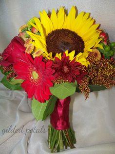 Gilded Petals yellow sunflower, orange pom, red gerbera daisy and green hypericum fall bouquet www.gildedpetals.com