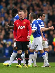 Wayne Rooney of Manchester United walks off the pitch after the final whistle.