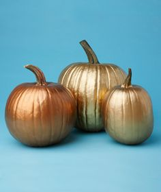 Pumpkins spray painted with metallic colors.