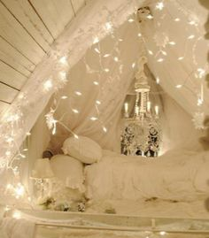 The chandelier and what look to be re-purposed holiday lights set this room, pinned by Brook Gibson from My Shabby Streamside Studio, aglow.  Visit our Dream Kids Rooms Pinterest Board to see the rest of our dream room picks, including some unique nurseries!  Photo Source: My Shabby Streamside Studio