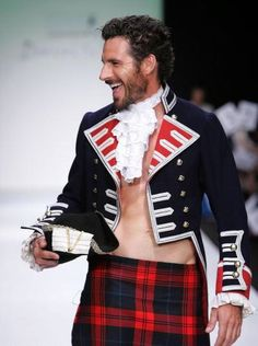 I find it ridiculous that he isn't wearing a shirt, but that's what makes it SO hot. <3    Ed, sir, you can wear the hell out of a kilt.