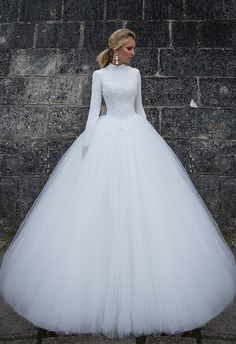 Oksana Mukha 2017 bridal collection ... I can hear the Sound of Music here. Glorious modern take on the modest winter ball gown wedding dress.