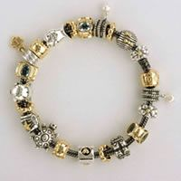 Love the look of the oxidized bracelet with the silver and gold mixed charms