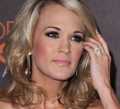 Carrie Underwood's engagement ring is a canary diamond engagement ring from hockey player Mike Fisher. This oval cut yellow diamond ring must make Underwood Carrie Underwood Engagement Ring, Carrie Underwood Wedding, Yellow Diamond Engagement Ring, Yellow Engagement Rings, Celebrity Engagement Rings, Engagement Ring Photos, Celebrity Rings, Celebrity Jewelry, Celebrity Style