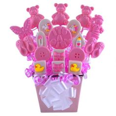 Sweet Baby Girl Lollipop Bouquet - wonderful personalized gift ideas online  Teddy bears, booties, storks and duckies are just a few of the sweet lollipops in this adorable baby girl tin. The arrangement is centered with an announcement Its A Girl lollipop.This is the perfect gift for the whole family to enjoy. Older siblings are sure to get involved in the taste testing.