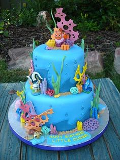 Use figurines and fondant for the coral/seaweed, brown sugar for sand, etc...