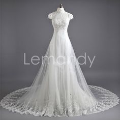 formal wedding dress in handmade high neck short sleeves tulle with lace applique. $264.00, via Etsy.