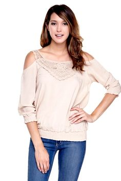 Modern top with shoulder cutouts. Crochet detailing on the front. Smocked cuffs and hem. Crochet. Modern. Top. Casual Top. Outfit. Fashion.
