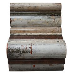 Dutch designer Piet Hein Eek is world famous for his scrapwood furniture. But he did more, e.g.: The tube chair is made of old pipes that were salvaged from the building he bought and renovated. http://www.pietheineek.nl