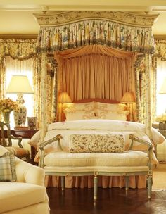 Beautiful lux bedroom in warm creams with gold and green. Stunning bed canopy and curtains