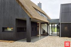 An exterior pivot door is an excellent way to make a grand entrance . This pivot door is fitted with FritsJurgens System One pivot hinge. Pivot Doors, Modern Barn, Grand Entrance, House Front, Inspired Homes, My Dream Home, Future House, Modern Architecture, Beautiful Homes