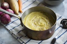 Here's a simple, robust, cold-weather soup that you can make with almost any mixture of root vegetables you have to hand: carrots, parsnips, celery root, turnips, rutabaga, sweet or regular potato Flavored with garlic, rosemary and bay leaves on top of a saute of onions and celery, it's an earthy, sweet, and warming meal for days where the air has some bite Top with a drizzle of olive oil and lemon juice, some grated cheese, flaky salt and a shower of black pepper.