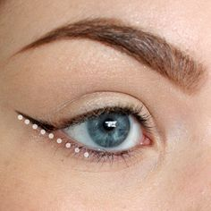 Line your first mark up with your lower lash line, as if the first mark was an extension of the bottom lash line. Place your brush/pencil at the outer corner of the line, and in one smooth and slow movement, glide the pencil/brush upwards as high as you want.