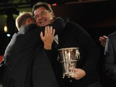 Vince Gill gets a hug from a friend after winning the