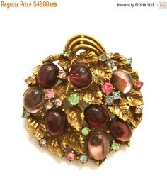 Glass Cabochon Rhinestone Leaf Brooch  Measurment: Approx. 1 3/4  Mark: None Condition: Very Good with slight darkening to foil on lilac cabs