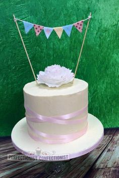 Kate - Christening Cake. Rustic Buttercream cake with gumpaste peony and colourful bunting.