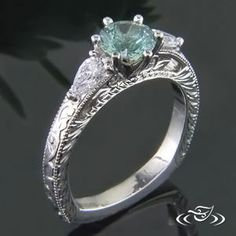 WOW green #sapphire and pear cut #diamonds are the stars in this scroll engraved #EngagementRing. #GreenLakeMade #Ido