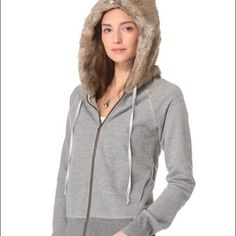 "♣️ NSF Sansa faux fur hoodie jacket grey small This is a gorgeous NSF fair fur hoodie. Size small. Bust 36"" waist 32"" length 22"".  A faux-fur hood gives a French terry hoodie a posh feel and the speckled jersey hem and cuffs create a subtle contrast. Zip closure and on-seam hip pockets. Long sleeves. Fine-knit lining Never been worn. Perfect condition Fabric: French terry Shell & lining: 100% cotton Hood: 77% acrylic/23% polyester Dry clean Made in the USA  From a clean, smoke free home  We…"