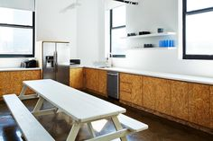 Picnic table dining in the Brad-Sherman-Workshop office kitchen for Mobile-Commons in Brooklyn, James-Ransom-photo| Remodelista-7