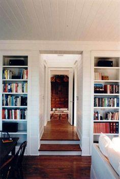 Perfect in so many ways: bookshelves; floors; sofa; step-down; doorways. Architect: Bosworth Hoedemaker.