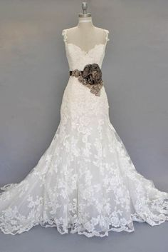 LOVE. The flower not as much. The detail and shape of dress is great!