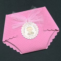 These pink diaper shaped personalized baby shower invitations feature a cute baby girl tag. The invitations are 4 tall and 5 1/2 wide at the widest