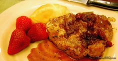 Pan-seared Pork Chops with a cranberry reduction.