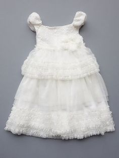 Isobella & Chloe spring Ivory Claire dress with soft ivory mesh over white lining with floral applique embroidered with iridescent beads. Absolutely radiant