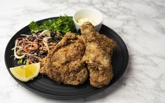 Learn how to make Karaage, the Japanese deep-fried chicken dish that is becoming amazingly popular thanks to the country's tradition for KFC at Christmas. Crispy Chicken, Marinated Chicken, Fried Chicken, Asian Slaw, Large Plates, Chicken Drumsticks, Recipe Please, Serving Plates, Kfc