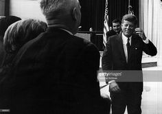 President John F. Kennedy leaves a press conference October 9, 1963 in Washington, DC.