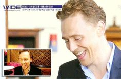 Tom Hiddleston Laughing At A Video Of Himself Laughing! He's so cute!