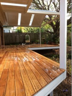Spantec Boxspan Steel Frame Deck with timber decking boards over. Perimeter beams and posts powder coated to match pergola over.