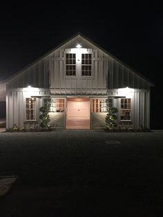 California Party Barn. Aisle End Doors by Lucas Equine Equipment.