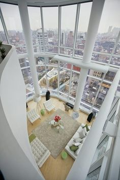 NYC. Duplex Penthouse with Manhattan Views  Marie Burgos. You see that is what kind of windows I want, especially in the city not only that but it brings in alot of natrual light, and come on, don't you love the modern and simple styles of the detalis and furniture!