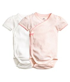 Check this out! CONSCIOUS. Wrapover bodysuits in soft, ribber jersey made from organic cotton with short puff sleeves, decorative picot trims and press-studs at the side and crotch. - Visit hm.com to see more.