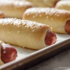 Low Carb Bagel Dogs or pretzel dogs are easy to make with the Fathead pizza dough recipe. Wrap, roll, & bake. The perfect low carb or keto lunch, or meal.